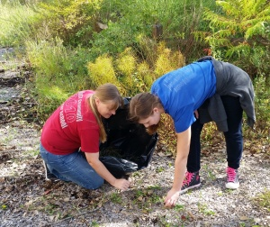 Students cleaning up in the outdoor classroom.